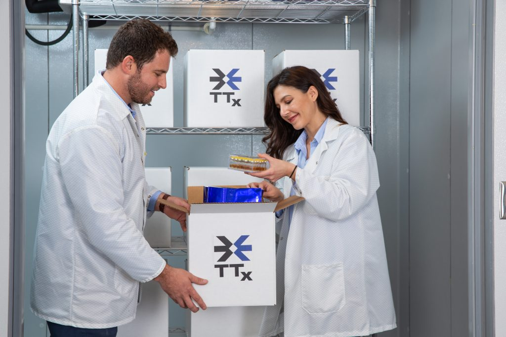 Scientists in lab coats conduct thermal packaging tests.
