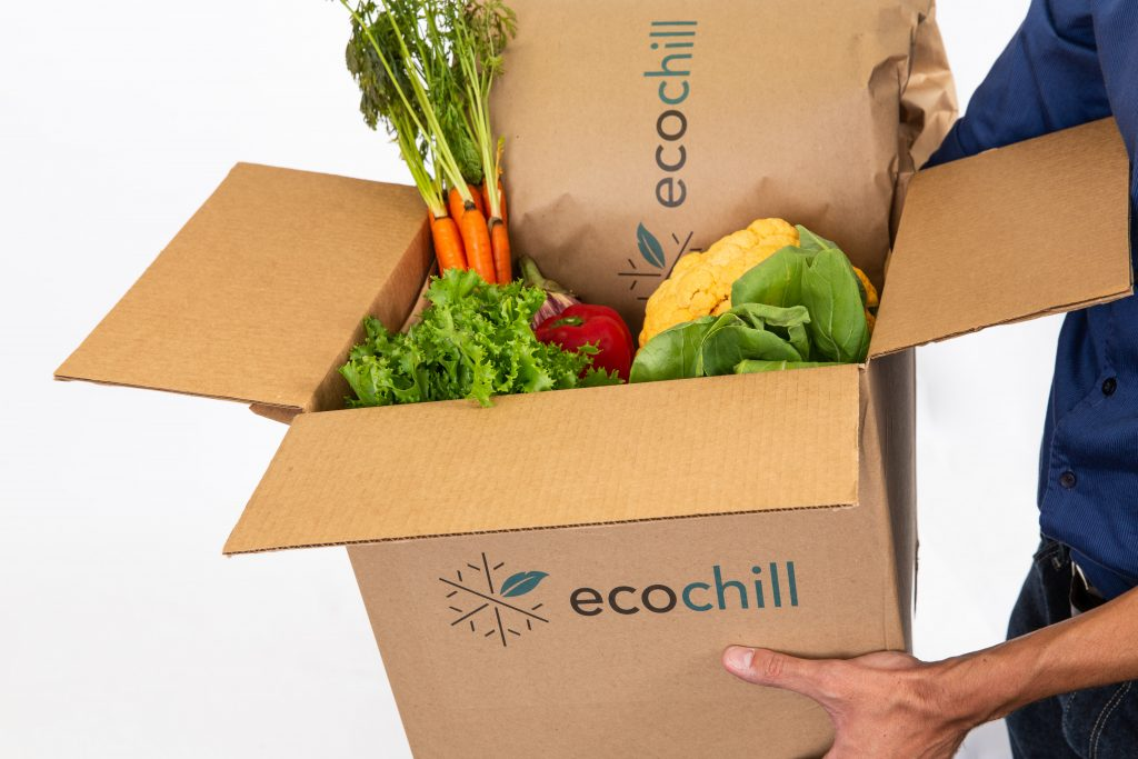 Insulated shipping box with fresh produce inside.